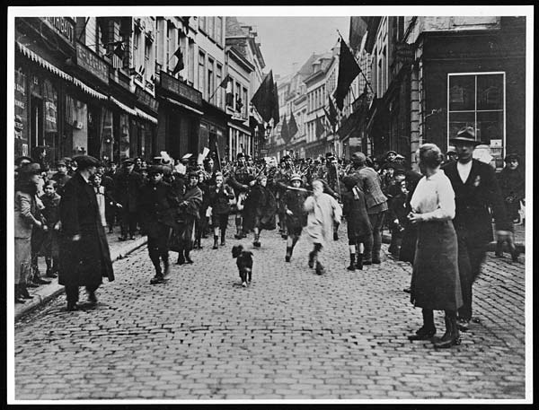 Canadians marching through the streets of Mons, November 11th 1918